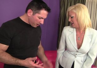 Blond cougar licks his ass then copulates him hard on the couch