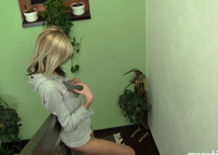 On the stairs and on the floor Cindy makes herself cum