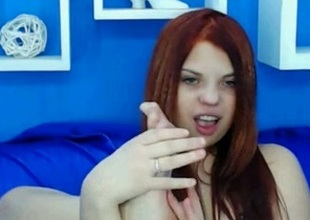 Redhead dreamboat shows her toes for the livecam and sucks them