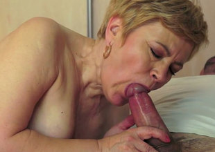 Chubby short haired granny blows and rides a young stud