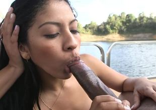 Two Colombian beauties are sucking off a guy in a threesome on a boat