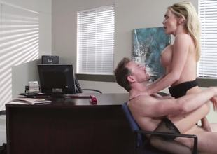 A hot golden-haired is getting her pussy spread open in the office today