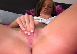 A girl is filmed as she by herself, fingering her wet pink flaps