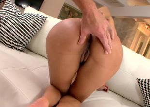 A fine round rump is getting oiled up and also kissed by a large man