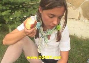 Brunette chick dildoing snatch on grass