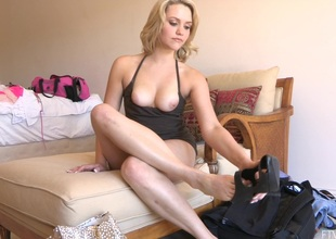 Blonde in black top removes her high heels and reaches out for vibrator