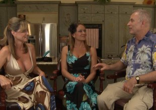 Two pornstars in pretty dresses talk to an old guy about sex