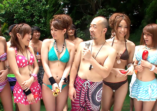 Beauties in bikinis are partying in the swimming pool