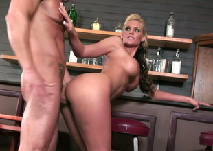 Lecherous MILF with fake boobs Phoenix Marie gets nailed in the bar