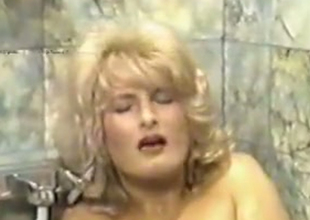 Classic blond milf bimbo in the bathtub is served with a dick