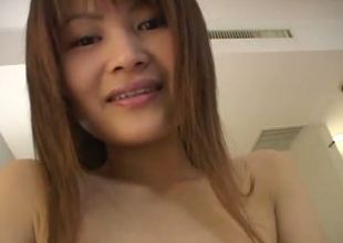 Kinky Japanese whore in fishnet pantyhose masturbating on camera