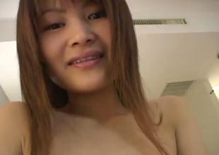 Kinky Japanese whore in fishnet pantyhose masturbating on camera
