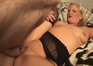 Spicy milf in black stockings Erica Moore gets banged by a young stud