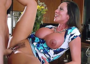 Elegant super sexy MILF Ariella Ferrera with huge titties seduces her daughters boyfriend to satisfy her raunchy desires. Breasty mamma gets her sexy bush heavily fucked in the kitchen!
