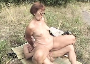 Messy grandma is not ever too old to taste dick and get fucked outside
