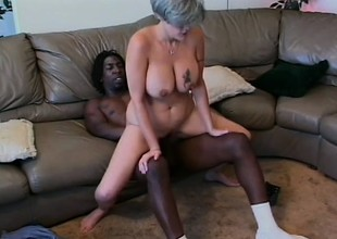 Busty aged woman can't get sufficiently of a black prick drilling her cunt