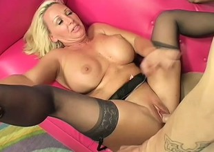 Blonde cougar Joanna seduces a young guy and has him fucking her vagina