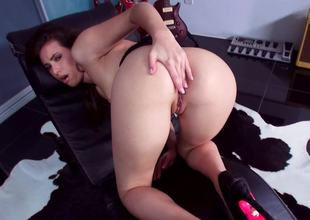 A hot bitch pushes a large dildo in her wet snatch in front of us