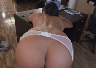 A huge ass chick is getting rammed in the office by her boss