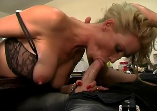 Busty golden-haired Diamond Foxxx wastes no time showing off her massive tits to Brian Surewood. She oils them up nicely in advance of dropping down to her knees to suck her high horse massive cock! She gets her tits fucked for some time in advance of Brian slams her cunt and then sw