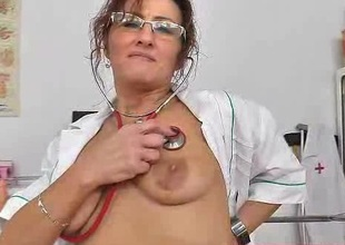 Mature European doctor dildoing herself in the hospital