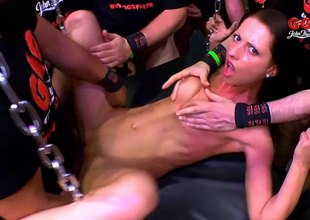 Masked men feed hard dick to a skinny bang slut