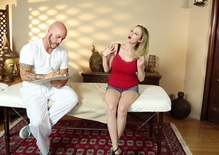 Tattooed golden-haired gets her huge boobs massaged by an expert