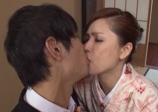 Horny Japanese brunette thorn sucks dong and rides it doggystyle