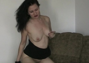 Undressed to fuck herself with a dildo