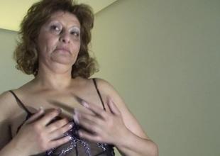 Mature slut soaking in front of the camera