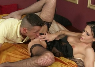 Perky ebony haired aged in fishnet nylons has an anal spermpie