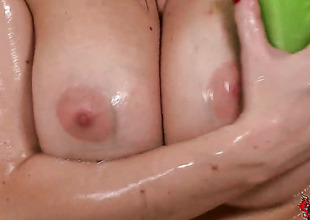 Blonde with shaved snatch has fire in her eyes as she masturbates
