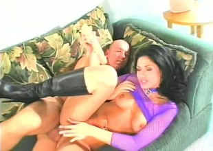 Raven haired Milf is getting her arse tapped hard and deep on the couch