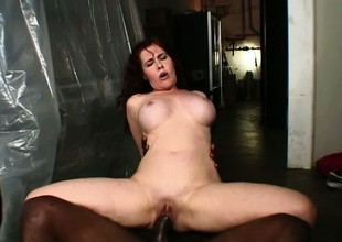 Incredibly hot Mae has giant titties and likes riding dark dick