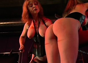 Roxanne Hall gets her wazoo beaten with a riding crop by Nina Hartley