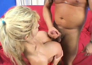 Lustful blonde mama with huge hooters wildly rides a youthful stud's shlong
