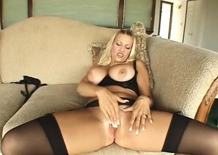 Big-breasted blonde broad with a gorgeous butt gets fucked hard