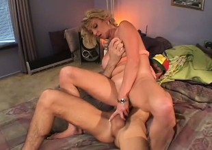 Busty blond MILF eats his tasty sausage and gets slammed in her slit