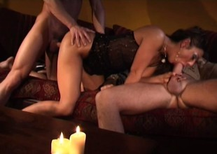 Alluring Latin babe Pilar Fuentes has fun with two young studs on the couch