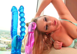 Blond is using 2 toys for her 2 holes