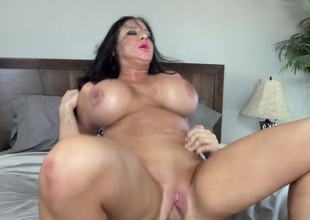 Massive fake titties on the milf sweetheart riding a big dick