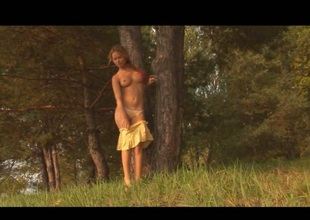 Delisious blonde fingering in the forest