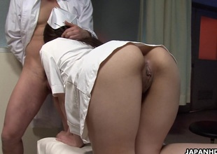 Naughty Japanese nurse has her trimmed cookie fucked by a doctor