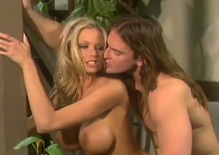 Slutty sexy and breasty golden-haired gets analfucked by long haired Tarzan