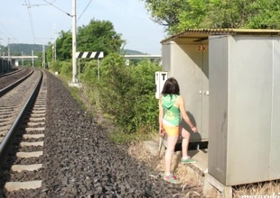 Out by the railroad this legal age teenager gets naked and rubs her pussy