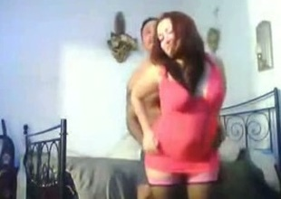 Fucking a chubby redhead hoe's cunt deep in the bedroom