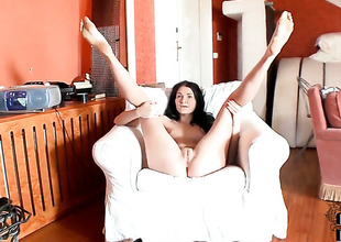 Chick playing with huge dildo