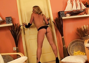 Blonde Kathia Nobili bares it all in a tempting manner