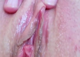Devilishly sexy slut Eileen with juicy love melons and smooth bush fucking herself with fingers on camera for your viewing pleasure