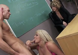 Protracted haired blond Julie Cash is a slutty breasty student girl. Curvy large titted girl with soaked as gets her hairless strong cum-hole banged hardcore style right in front of curious older woman in the classroom.
